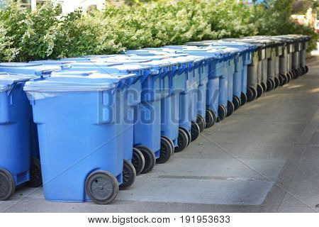 Modern blue grey garbage bin in Canada.