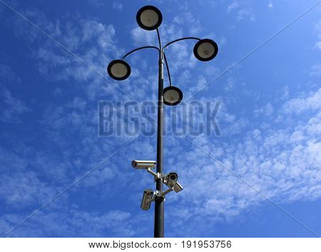 street lights with surveillance cameras on lamppost