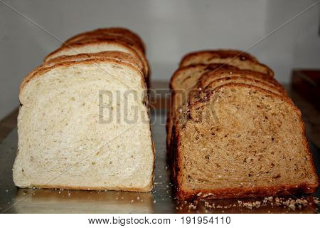 White and wheat loaf bread Healthy white bread and wheat bread side by side in a metal tray