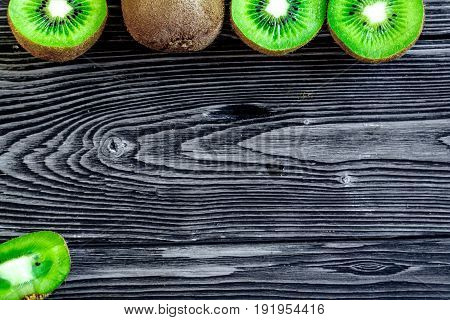 Exotic Fruit Design With Kiwi On Dark Wooden Background Top View Mock Up