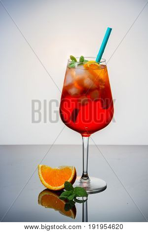 Glass of spritz long drink coctail on table