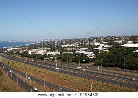 Highway Heading Toward And Leaving Coastal Urban Landscape