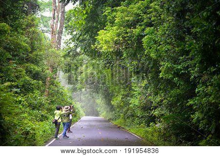 KHAO YAI, PRACHINBURI, THAILAND-MAY 22, 2017: Bird watchers and nature lovers watching birds in Khao Yai national park.