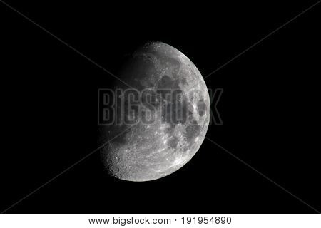 quarter moon, right side Right side view of a quarter moon with a black background
