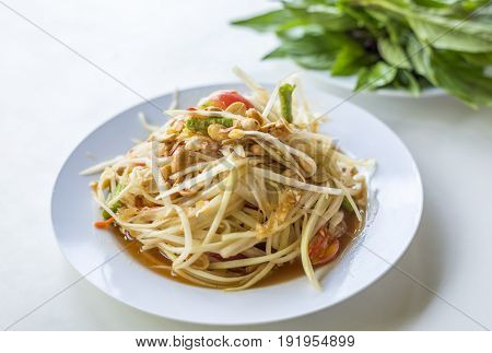 Papaya Salad called SomTum a Thai tradition food for diet. The taste is spicy and sour.