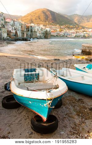 Touristic and vacation pearl of Sicily fishermen boats in small town of Cefalu Sicily south Italy