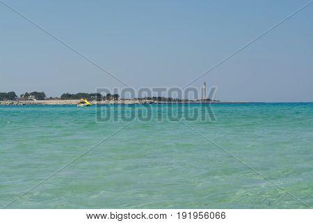 Beautiful White Sand Beach In San Vito Lo Capo, Sicily, Italy With Orange Umbrellas