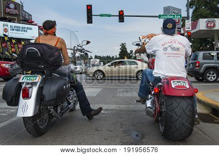 Sturgis South Dakota - August 8 2014: Two riders stopped at a red light in thecity of Sturgis in South Dakota USA during the annual Sturgis Motorcycle Rally