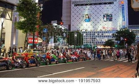 Tokyo, Japan - 26.6.16: People enjoying a carting experience in the busy streets of Shibuya, Tokyo.