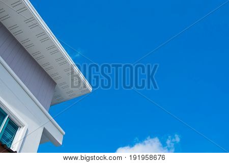 White Eaves With Ceiling And Roof Of Modern House Against Blue Sky.