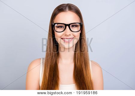 Cute Young Female Student Is In A Stylish Black Glasses, Wearing Casual Singlet, Smiling, Standing O