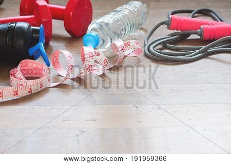 Sport equipments Fitness items on wooden floor Healthy lifestyle