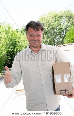 a delivery man at home with parcel