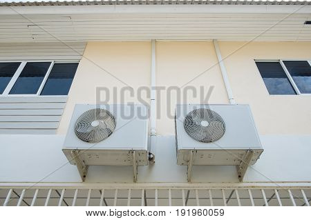 Air Conditioner Compressor Unit Hanging On The Wall,
