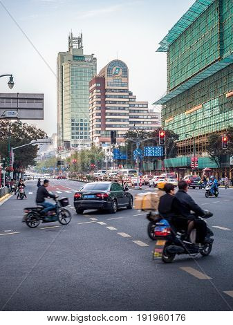 Shanghai, China - Nov 4, 2016: On Xizang Road (Middle) - Traffic scene bathe in late afternoon sun. Peak hour congestion beginning on one side of the road (right). Street photography.