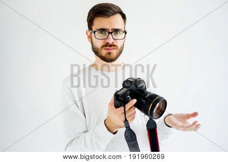 Portrait of a male photographer who has a problem
