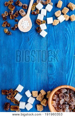 Lumps And Sanding Sugar For Sweets On Blue Kitchen Table Background Top View Mock Up