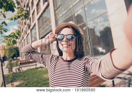 Dreamy Relaxed Young Girl Is Making Selfie Shot On Camera While Walking In The Spring Sunny City Out