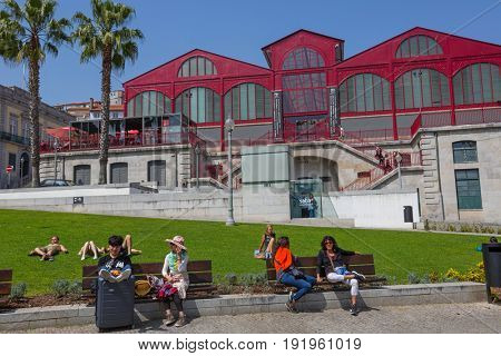 PORTO, PORTUGAL - April 17, 2017: People at Old Town streets of Porto. Porto is the famous tourist destination in Portugal