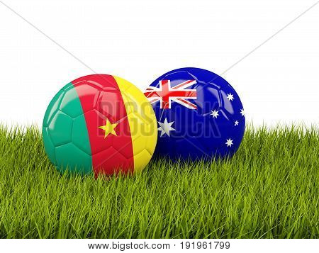 Two Footballs With Flags Of Cameroon And Australia On Green Grass