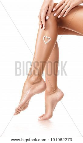 Woman with cream on the legs and water reflection. Moistening concept.