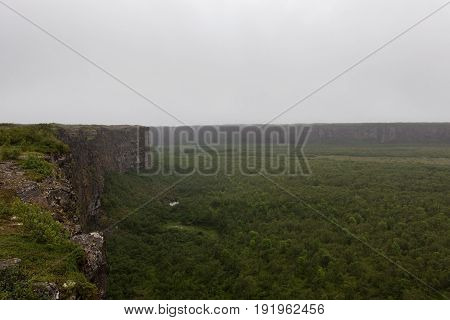 Breathtaking Horseshoe Landscape Near Asbyrgi, Northern Iceland. Huge Cliffs Surrounding Green Wet F
