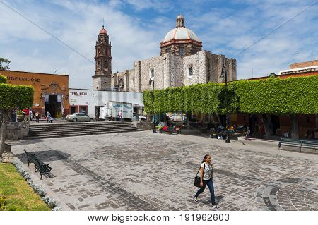 San Miguel de Allende Mexico - May 28 2014: People in a square in the historic center of the city of San Miguel de Allende Mexico.