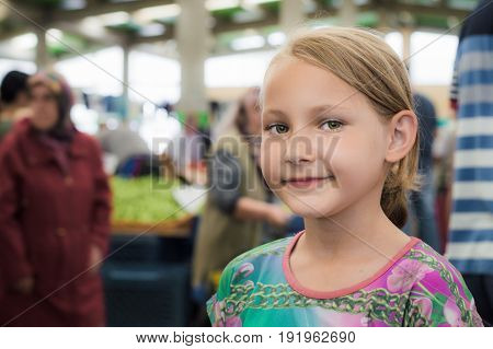 Eskisehir, Turkey - June 15, 2017: Portrait Of A Smiling Sweet Little Blonde Girl With Green Eyes In
