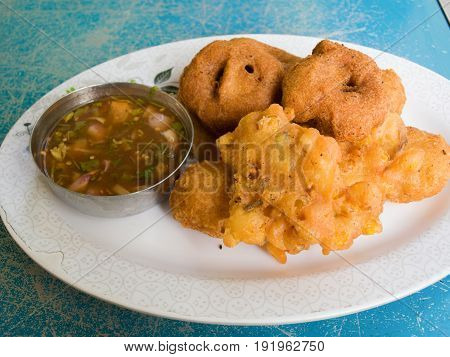 COLOR PHOTO OF TEMPURA: VEGETABLES COVERED IN BATTER AND FRIED