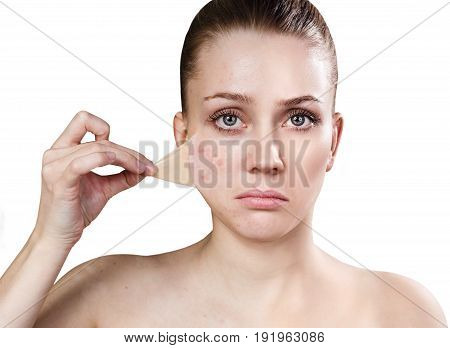Beautiful woman remove her old dry skin from face. Isolated on white.