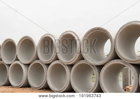 Concrete drainage pipes for industrial building construction.Isolated on white background