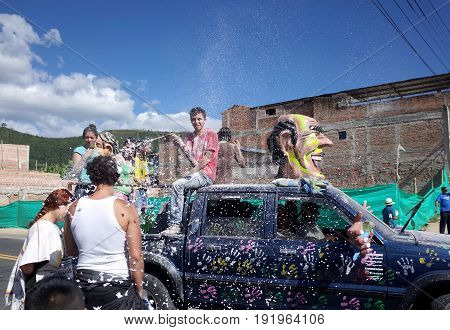 5TH JANUARY 2015 CHICHAGUÍ COLOMBIA - a truck sprays foam at the crowd during the celebrations at the Carnival de Blancos y Negros (Blacks and White Carnival) in Chichaguí near Pasto in Colombia