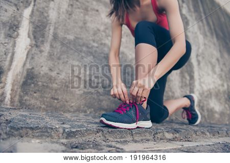 Close Up Low Angle Of Young Sporty Woman, Tying Laces Of Running Shoes Before Training Outdoors, In
