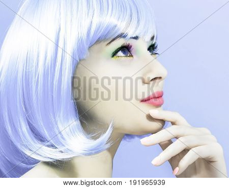 Beautiful woman in makeup with a bright purple wig