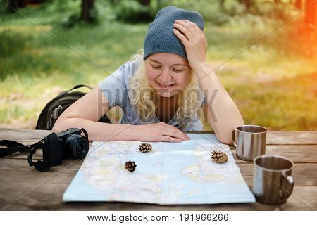 Woman Planning Road Trip With Maps.