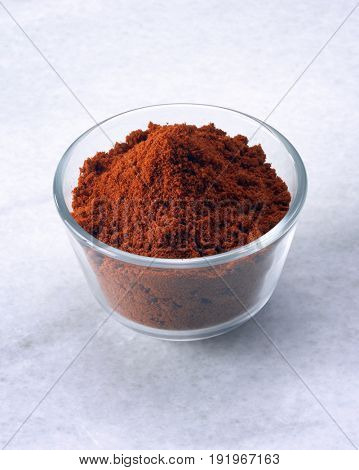 a bowl of spices (curry powder)