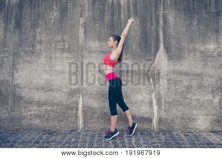 Young Sportwoman Trainer Is Making Stretching Outdoors In Town. She Is So Relaxed And Healthy, Weari