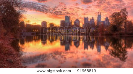 Beautiful panoramic view of Lake Clara Meer Piedmont Park Aquatic Center and Midtown Atlanta in autumn twilight USA poster