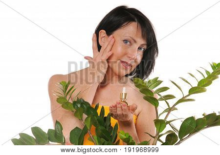 mature woman doing rejuvenation spa procedure for face on white background. Beauty and care concept