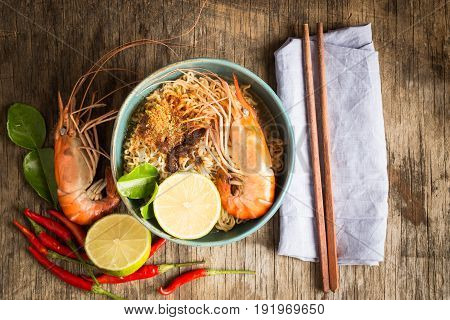 Instant Noodles with Shrimp on Old Wooden Table,Top View ,Thai food tom yum kung
