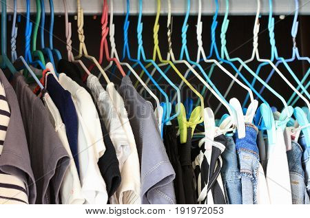 Clothes Hanging in the Closet by wired hangers with clips