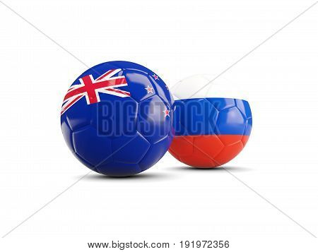 Two Footballs With Flags Of New Zealand And Russia Isolated On White