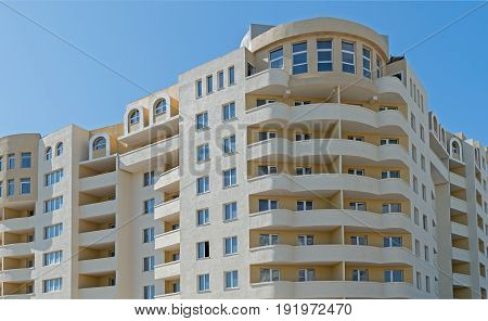 Modern new executive apartment building on background of blue sky