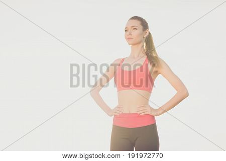 Attractive Fit Sportgirl With Hands On Waist Is Ready For Work Out. She Is Wearing Stylish Sport Wea