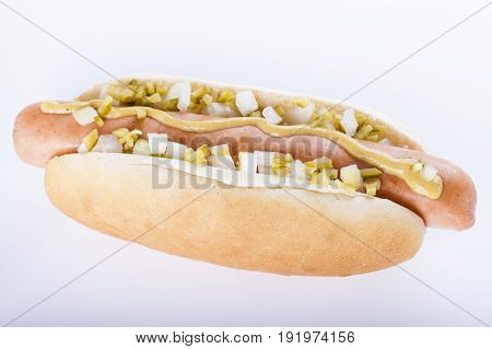 Hot Dog Grill With Mustard, Onion And Pickles Isolated On White Background.