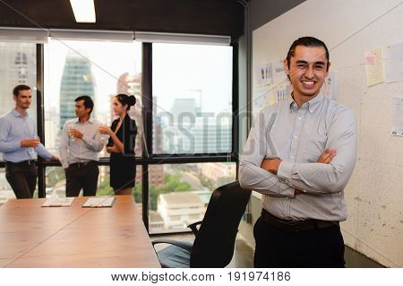 handsome businessman stand and smile look to camera in the office business successful concept