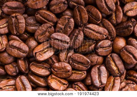 roasted brown coffee beans and powder background