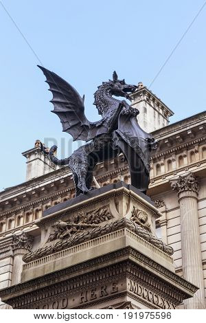 LONDON, GREAT BRITAIN - MAY 9, 2014: The Temple Bar monument is a bronze griffin on a high pedestal on the border of the City and Westminster.