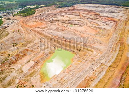 Kaznejov kaoline quarry. Aerial view to largest quarry of its kind in Europe. Heavy industry from above. Industrial area and devastated landscape in Czech Republic.