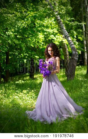 Young woman with flowers in the forest (without sunrays ver)